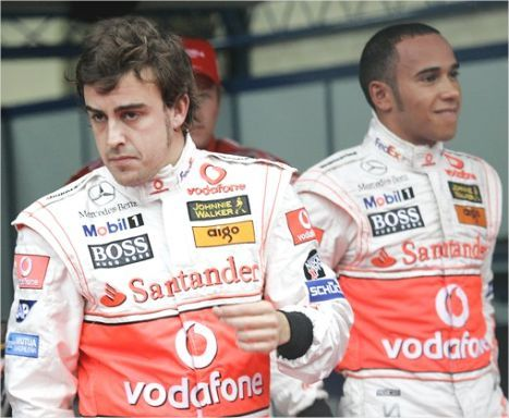 Fernando Alonso, left, and Lewis Hamilton, after qualifying in Japan on Saturday. Chitose Suzuki AP.jpg